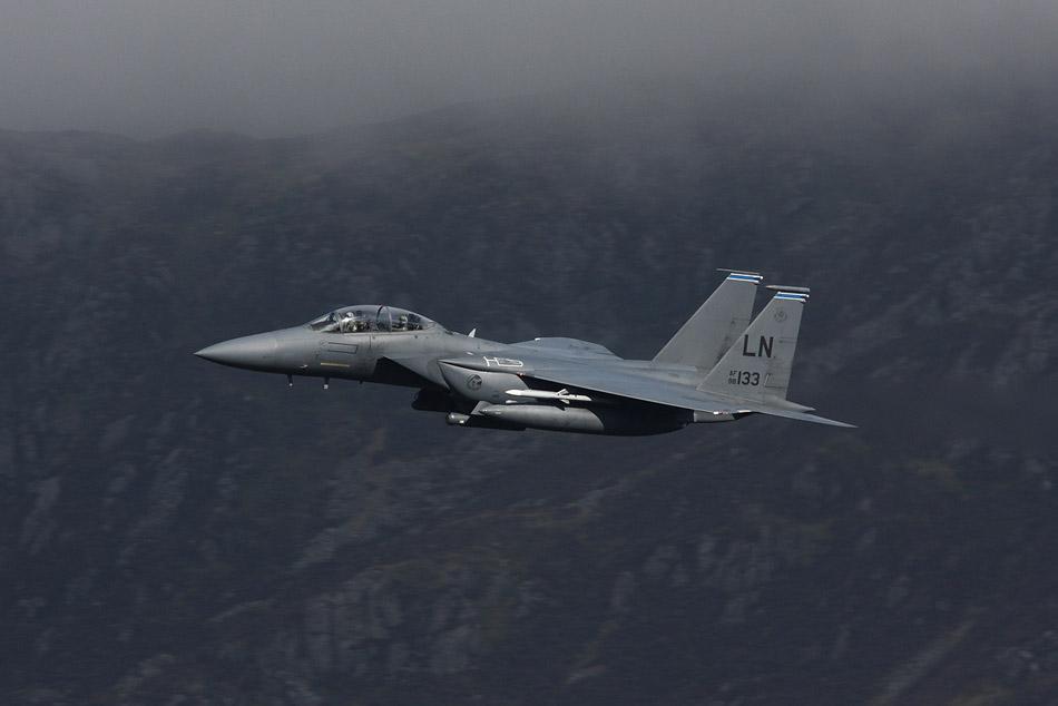 492 FS, 48 FW F-15E Strike Eagle (98-0133 'LN') just below the mountain top cloud