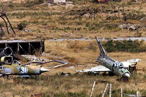 Destroyed Taliban MiGs lie on the Bagram air base frontline 2001.