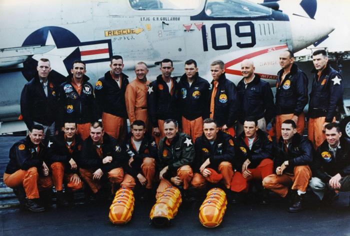 VF-111 Sundowners pilots near an F-8D Crusader on board of the USS Kitty Hawk in 1963